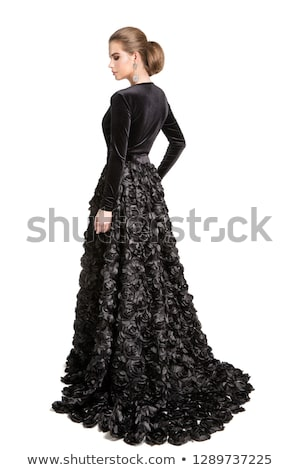 bacl view of a woman in a black gown stock photo © feedough
