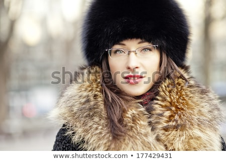 Woman wearing fur hat and glasses Stock photo © Kor