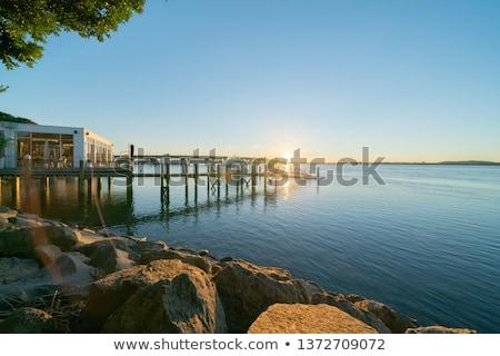 bridge or pier across an expanse of sea stock photo © juniart