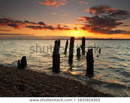 Sunset over jetty remains Stock photo © thisboy