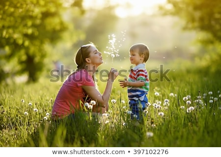 Young family, parents with children,  playing in a field Stock photo © monkey_business