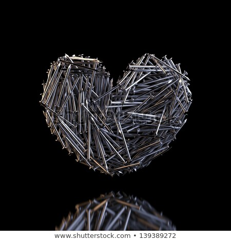 heart created out of nails reflection on black background stock photo © vizarch