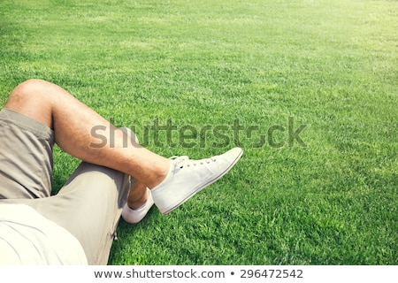 man lying down on a field and thinks  Stock photo © feedough