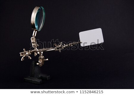 figure of steel man with blank piece of paper - copy space Stock photo © Hochwander