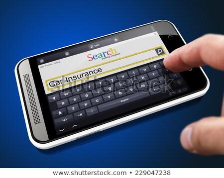Ubezpieczenia wyszukiwania ciąg smartphone zażądać palec Zdjęcia stock © tashatuvango