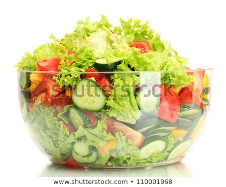 Big tomato on green salad isolated on white stock photo © entazist