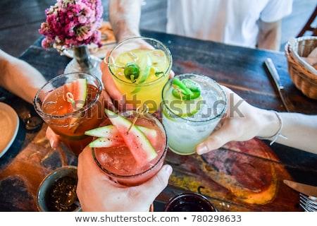elegante · jonge · vrouw · drinken · cocktail · witte · studio - stockfoto © nyul