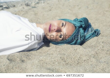 Beautiful blonde wrapped in scarf at the beach Stock photo © wavebreak_media