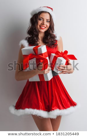 Pretty girl holding hands out in santa outfit Stock photo © wavebreak_media