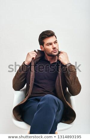 Modelo sessão estúdio as pernas cruzadas olhando maneira Foto stock © feedough