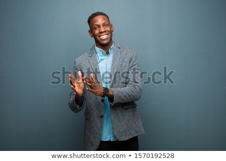 Happy afro american man clapping hands Stock photo © deandrobot