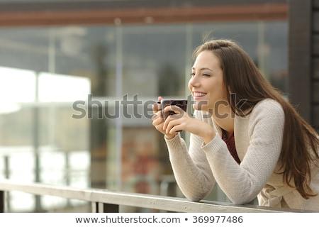 Töprengő nő iszik kávé kint portré Stock fotó © deandrobot