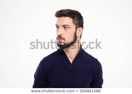 potrait of attractive thoughtful young man with beard in sweetshirt stock photo © deandrobot