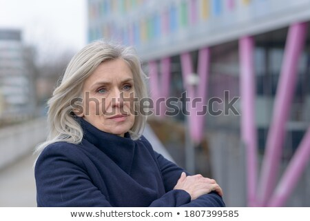 Smiling woman looking back over railing Stock photo © dash