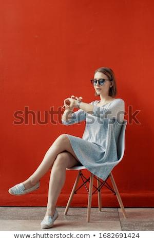 Güzel kız oturma sandalye deri ofis koltuğu açık Stok fotoğraf © FAphoto