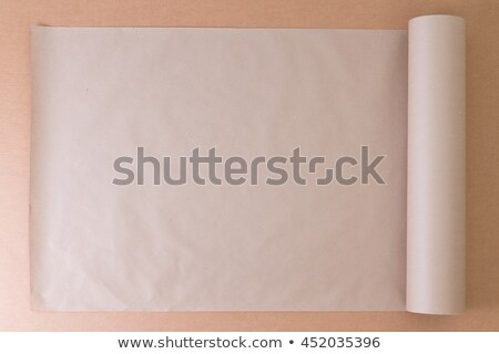 Opened roll of plain brown paper on cardboard Stock photo © ozgur