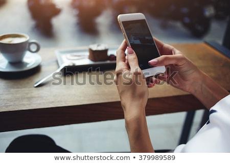 filiżankę · kawy · smartphone · notatnika · drewniany · stół · górę · widoku - zdjęcia stock © dolgachov