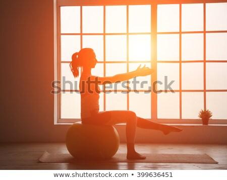girl with pilates ball at sunset stock photo © adrenalina