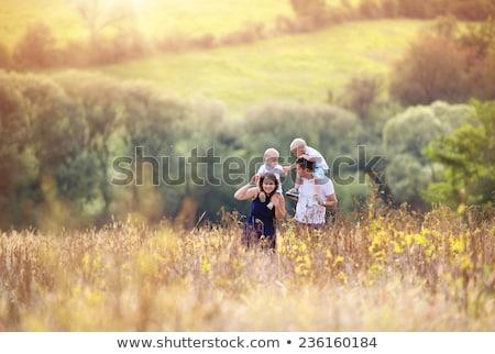 Enjoying childhood at summer vacation walking on grass meadow Stock photo © zurijeta