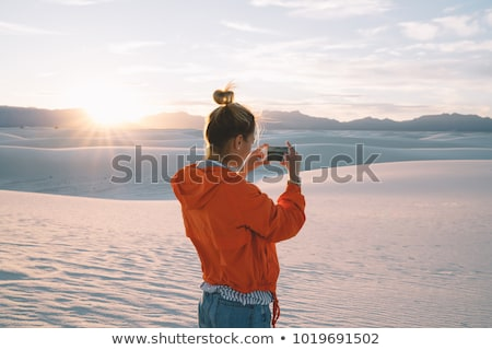 Woman photographs to a smartphone Stock photo © OleksandrO