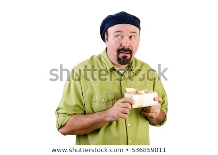Nervous middle aged man with wrapped present Stock photo © ozgur