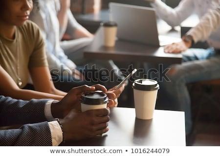 üzletasszony · iszik · kávé · beszél · mobil · fiatal · felnőtt - stock fotó © stevanovicigor