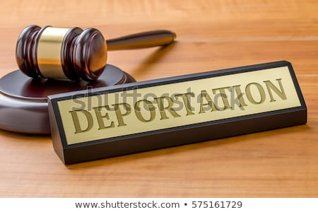a gavel and a name plate with the engraving deportation stock photo © zerbor