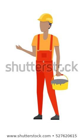 Builder in Helmet and Uniform. Bucket of Cement Stock photo © robuart