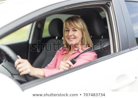 attractive senior woman drives a car stock photo © nobilior
