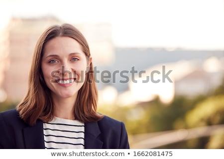 Stockfoto: Zakenvrouw · permanente · buitenshuis · gebouw · glimlachend · business