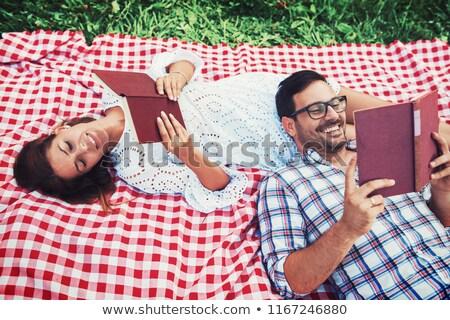 Couple lying on picnic blanket in park Stock photo © wavebreak_media