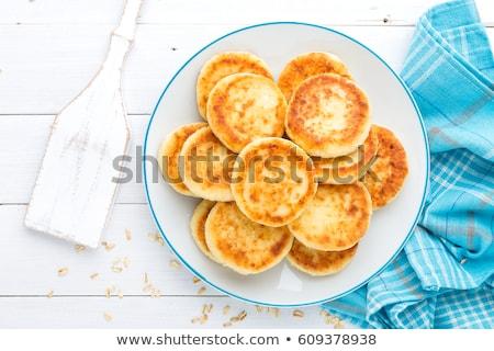 Cottage cheese pancakes with oats, syrniki on white rustic background Stock photo © yelenayemchuk