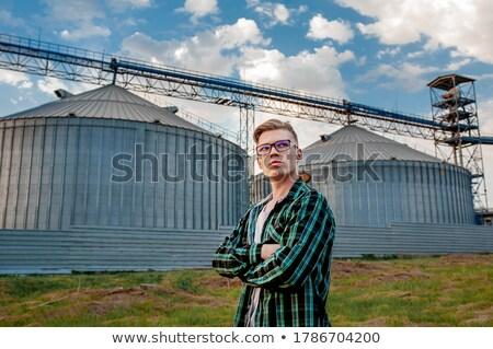 фермер · Постоянный · фермы · зданий · здании · улыбаясь - Сток-фото © monkey_business