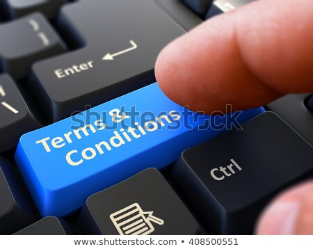 Pressing Blue Button Terms and Conditions on Black Keyboard. Stock photo © tashatuvango