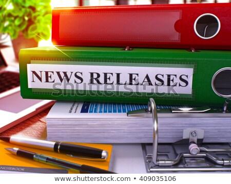 green ring binder with inscription news releases stock photo © tashatuvango