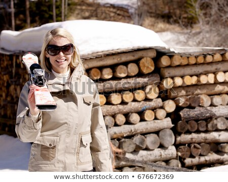 woman carrying skis by log pile Stock photo © IS2