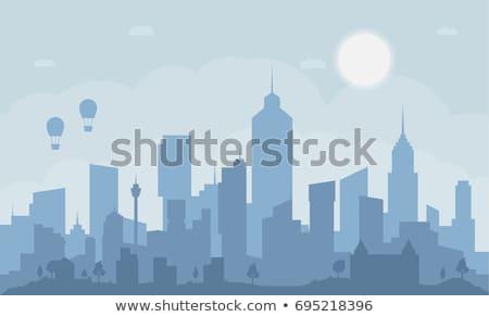 City Scape silhouette nuages vue eau bâtiment Photo stock © Taiga