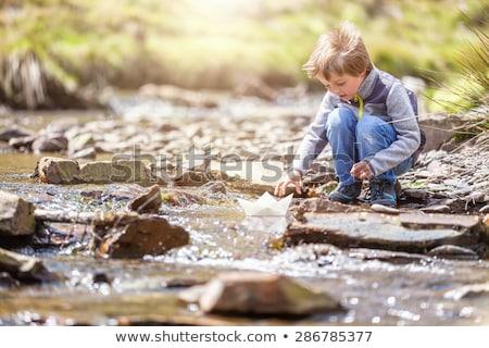 Chłopca gry papieru staw zabawy Zdjęcia stock © IS2