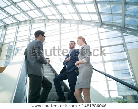 Affaires escalator homme costume Homme permanent Photo stock © IS2