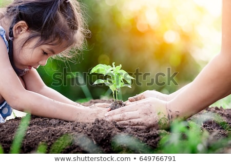 Girl and parents in garden Stock photo © IS2
