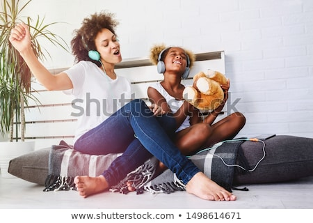 Daughter and mother listening to music Stock photo © IS2