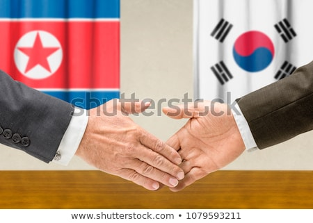 Representatives of North Korea and South Korea shake hands Stock photo © Zerbor