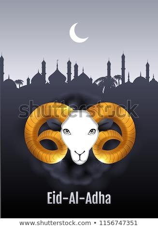 Eid al Adha text greeting card. Gold ram head of sheep Stock photo © orensila