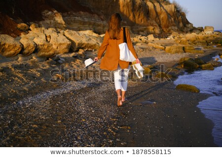 portrait of an elegant woman relaxing on a beach with her belove stock photo © majdansky