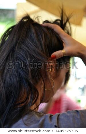 beautiful girl with hairdo on balck background Stock photo © svetography