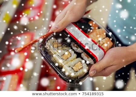 Mãos sushi empacotar mercearia supermercado venda Foto stock © dolgachov