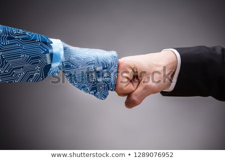digital generated human hand and businessman making fist bump stock photo © andreypopov