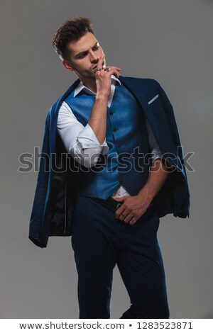 portrait of pensive gentleman in blue suit looking to side Stock photo © feedough