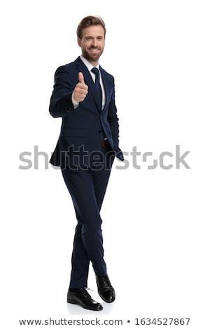 Atraente moço azul terno as pernas cruzadas Foto stock © feedough