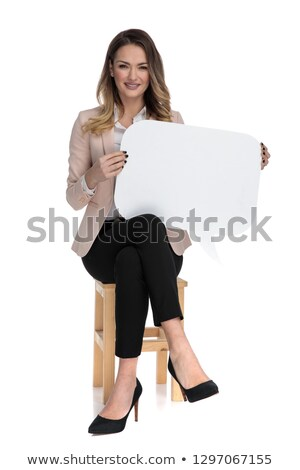 businesswoman sitting cross-legged holds speech bubble and smile Stock photo © feedough